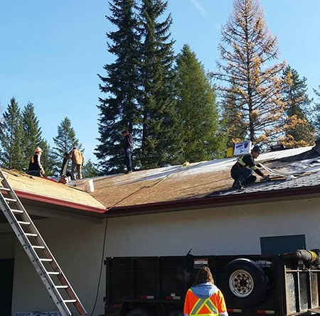 Vernon Roofers Completing a New Shingled Roof-min
